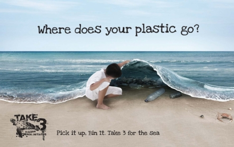 Child looking inside the sea for plastic